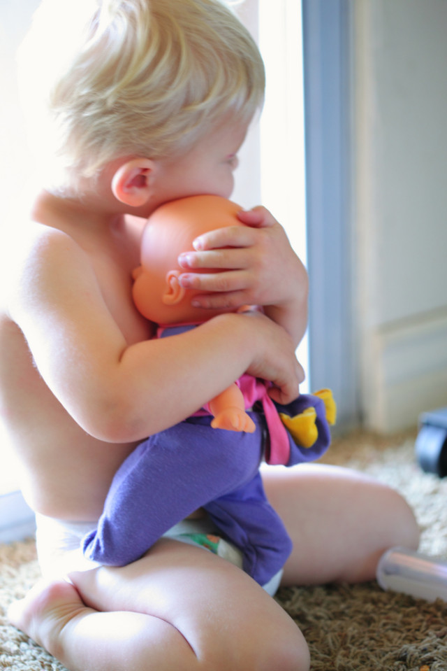 Little Daddy Hugging Baby Doll